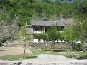 5000 sq.m. land with cottage,  boundary,  orchard,  retaining walls,  park